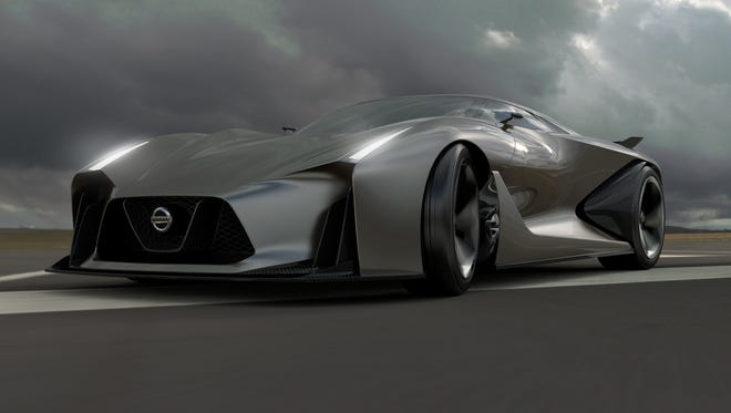 Nissan shows it drawings of  Concept 2020 Vision Gran Turismo, a vision of what a high performance Nissan could look like in the future. It's for the PlayStation video game unit.