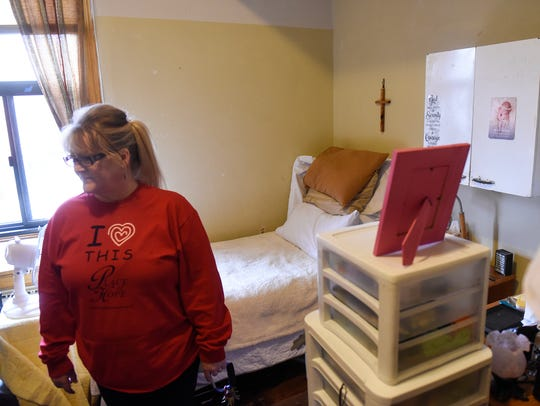 The Rev. Carol Smith stands in one of the rooms of