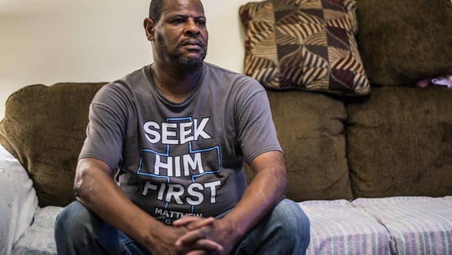 Charles Polk sits in his home in Monroe, N.C. Polk completed the Recovery Connections Community program in 2017 but says its director, Jennifer Warren, thinks only about money.