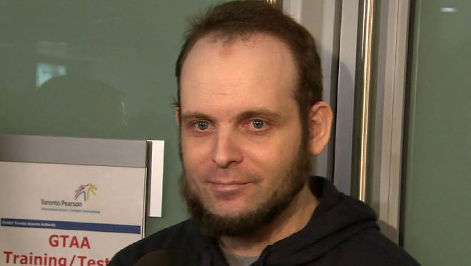 Freed Canadian hostage Joshua Boyle gives an interview Nov. 14, 2017, to CBC News upon his arrival at Toronto Pearson international airport.