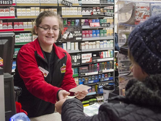 Casey's General Store employee KaSandra Krietlow hands Janell Smith her receipt after a purchase Thursday, Jan. 4, in Dell Rapids. Sales tax revenue in 2017 for the City of Dell Rapids set a new record.
