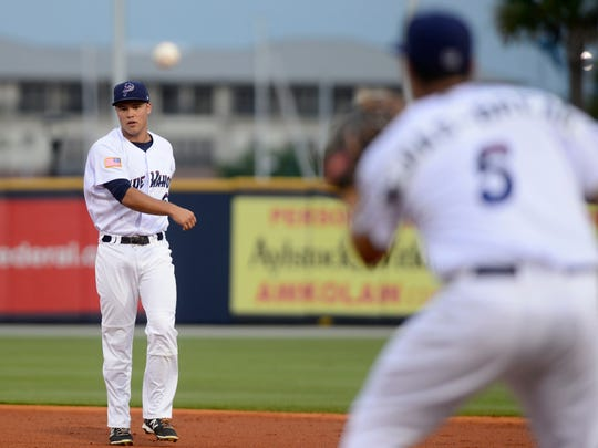 Pensacola Blue Wahoos' Ryan Wright throws to first
