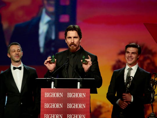 Christian Bale tells Palm Springs International Film Festival Awards gala attendees to steal the souvenir crystal Buddhas.
