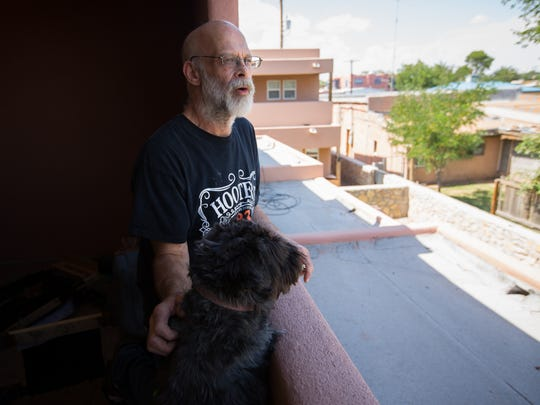 Wade Taylor looks out from his back patio with his dog Tigger, June 8, 2016.