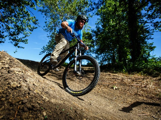 James Flatten of Singletrack Trails rides one of the