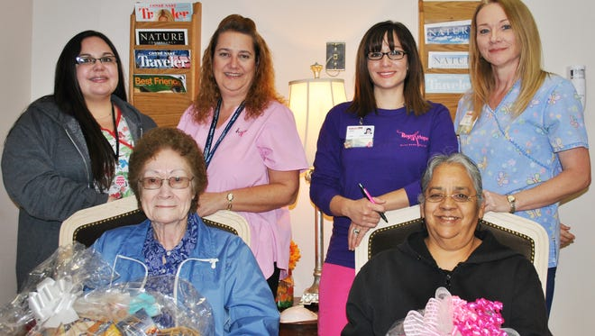 Celebrating Breast Cancer Awareness Month at GRMC were, back row from left: Medical Imaging Manager Ashley Burkos; Mammography Tech Erin Zubia; Mammography Tech Ariel Archer; Deborah Telles. Front row, from left: basket winners Wilma Tapscott and Lydia Reyes.