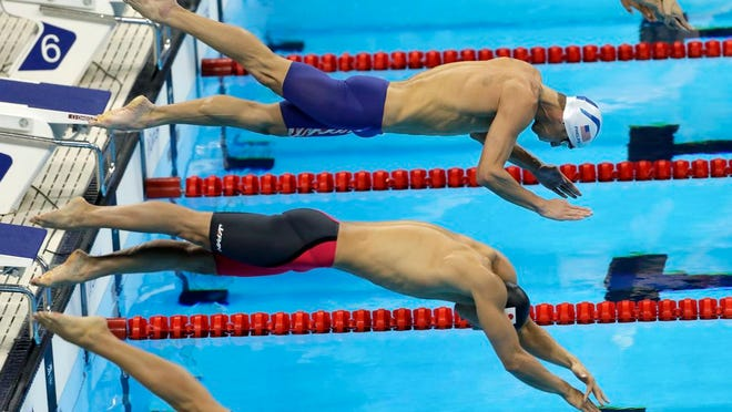From Aug. 10, 2016, United States' Michael Phelps, top, and Japan's Hiromasa Fujimori compete in a heat of the men's 200-meter individual medley during the swimming competitions at the 2016 Summer Olympics. Fujimori lost his appeal Friday, March 6, 2020 against a two-year ban for a positive doping test and will miss the Tokyo Olympics.
