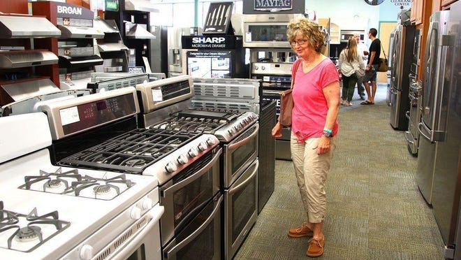 Colleen Farrell, of Weymouth, shops for appliances during the 2015 sales tax holiday weekend.