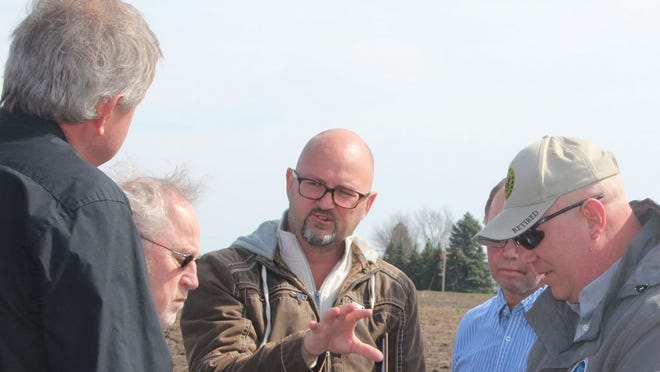 Dave Swantek of the Minnesota Department of Affairs (center) talked about the veterans cemetery site during a 2019 visit.