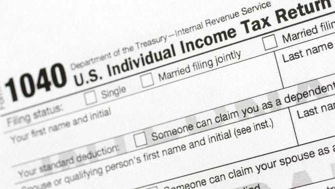 FILE - This July 24, 2018, file photo shows a portion of the 1040 U.S. Individual Income Tax Return form.