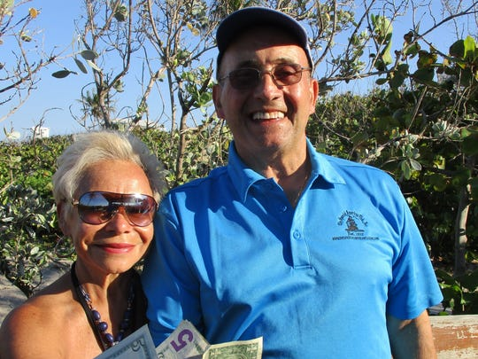 Elizabeth Mejia, left, and Rubén Aleman were 50/50 winners at the Spanish American Club's annual picnic.