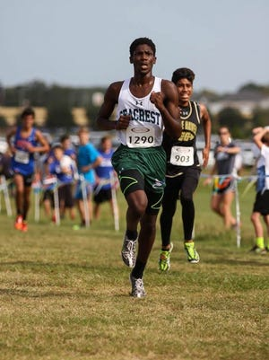 Seacrest Country Day junior Peter Charles heads toward the finish line at the Class 1A-Region 2 meet in Lakeland. Charles finished third to qualify for his first state meet, narrowly missing making it as a sophomore last year.