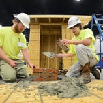 Jonathan Burrell, left, and Chandler Ashley, both students at the Rankin Career and Technical Center,  work on their team's garden shed during the Team Works event at the SkillsUSA/MCEF State Championship at the Mississippi Trade Mart in Jackson on Wednesday.  During the two-day competition, high school and community college students, and apprentices, participate in team and indidvidual events in a variety of construction diciplines.