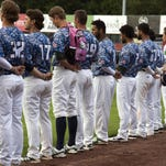 The Lake Monster's line up to listen to the National Anthem during the baseball game between the Auburn Doubledays and the Vermont Lake Monsters at Centennial Field on Wednesday night July 22, 2015 in Burlington, Vermont. (BRIAN JENKINS/ for the FREE PRESS)