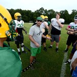 Catholic High School special teams coordinator Christian Macon gathers his players during the first week of fall practice.