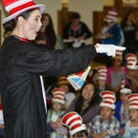 Ashley Brown helps children and adults kick off Read Across America Saturday at the Tulare Public Library.