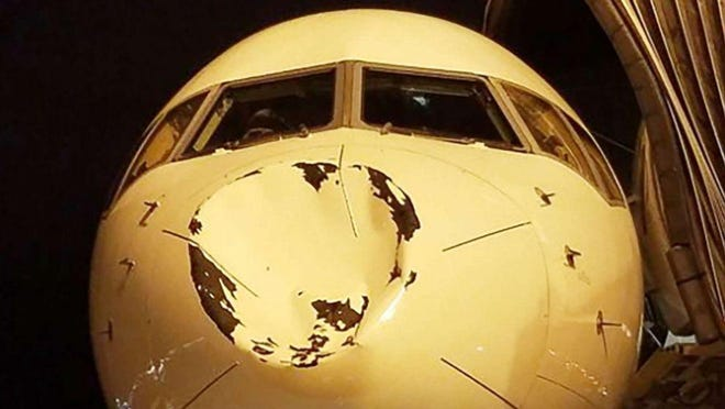 Delta Air Lines says a charter flight carrying the Oklahoma City Thunder from Minneapolis to Chicago apparently encountered a bird early Saturday when it was landing, causing damage that prompted some players to post photos on social media showing the caved-in nose of the plane.