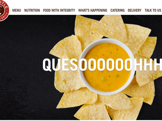 Chipotle's queso surrounded by chips.