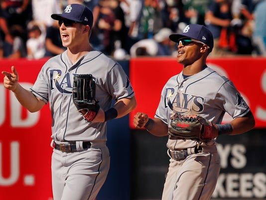Tampa Bay Rays' left fielder Corey Dickerson, left, and Rays center fielder Mallex Smith celebrate after their 5-3 victory over the New York Yankees  in a baseball game in New York, Sunday, July 30, 2017. (AP Photo/Kathy Willens)