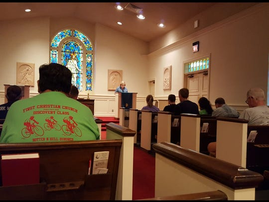 A brief prayer service is offered to riders staying