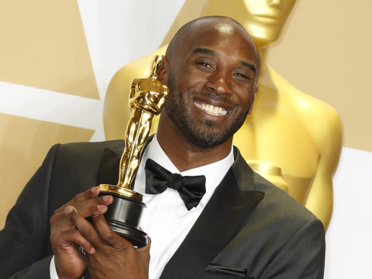 """Kobe Bryant holds the Oscar for best animated short for """"Dear Basketball"""" after the 90th annual Academy Awards ceremony in the Dolby Theatre in Hollywood."""