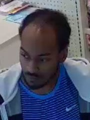 Police say this man used stolen credit card information to purchase a bag of dog food and a gift card from Pet Supplies Plus.