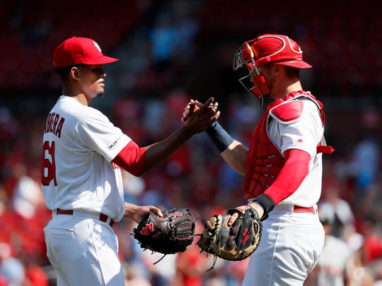 Former Springfield Cardinals starting pitcher Genesis Cabrera, left, and catcher Andrew Knizner celebrate their victory over the San Francisco Giants in a baseball game Thursday, Sept. 5, 2019, in St. Louis.