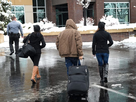 David Chavez-Macia, center, walks to the ICE office