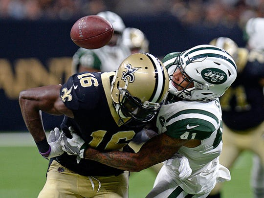 New Orleans Saints wide receiver Brandon Coleman (16) fumbles as he is hit by New York Jets cornerback Buster Skrine (41) in the second half of an NFL football game in New Orleans, Sunday, Dec. 17, 2017. (AP Photo/Bill Feig)