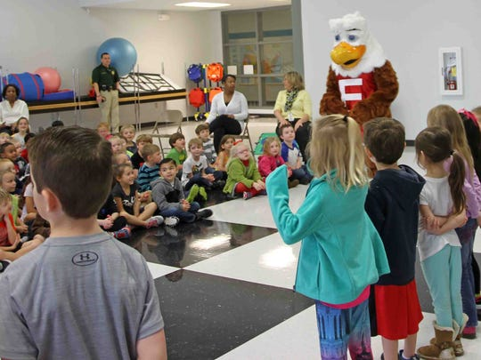 Students at Carmel Elementary interact with Eddie Eagle,