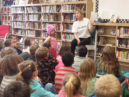 United Way volunteer, Shannon Hoiland, reads to second