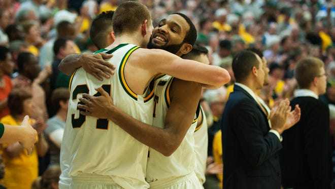 Catamounts guard Kurt Steidl (34) and Catamounts guard Dre Wills (24) hug during the closing seconds of the men's basketball game between the Stony Brook Seawolves and the Vermont Catamounts at Patrick Gym on Saturday afternoon February 25, 2017 in Burlington.