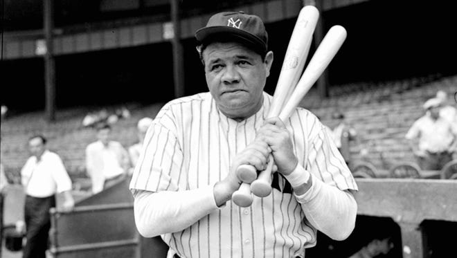 Retired Yankees slugger Babe Ruth warms up before stepping to the plate at Yankee Stadium in 1942 as he prepared for a hitting exhibition.