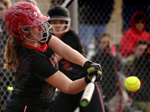 Wauwatosa East's Shea Murphy connects with a pitch