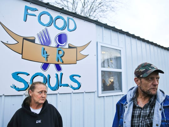 Debby Eldridge, left and Perry Barter stand outside the Food 4 R Souls building at the New Covenant Church in Austin. Both visit the free dinner provided every Thursday to any those who need it. Barter, a former addict, said he's clean now and hopes that Austin won't be always known for the HIV crisis that hit the small town in 2015.