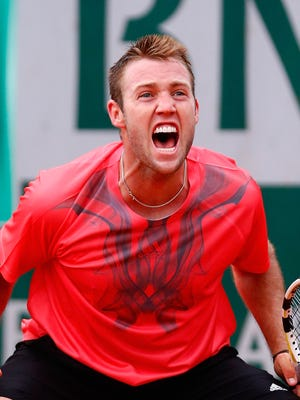 Jack Sock of the United States celebrates match point during his match against Pablo Caerreno Busta of Spain on Day 5 of the French Open.