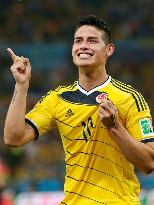 FILE - In this June 28, 2014, file photo, Colombia's James Rodriguez celebrates after he scored his side's second goal during the World Cup round of 16 soccer match between Colombia and Uruguay at the Maracana Stadium in Rio de Janeiro, Brazil. The 23-year-old Monaco forward who was the top scorer at the World Cup, is closing in on a deal with Real Madrid. Spanish sports newspapers said Monday that Monaco had agreed terms with Madrid and Rodriguez is to be presented to fans on Tuesday. (AP Photo/Marcio Jose Sanchez,File)