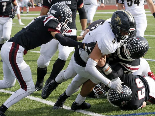 Corning's Jason Rodriguez is brought down by three