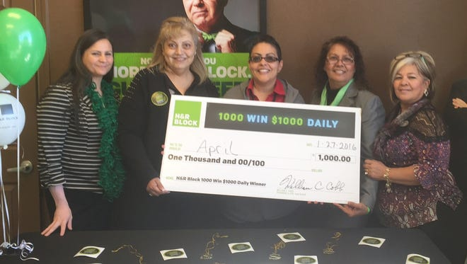 """April Carlos, center, received a check for $1,000 as the big winner of H & R Block's daily drawing for its clients. It's refund season and to celebrate H & R Block is giving away $1,000 daily. The sooner you enter, the more chances you have of winning. """"I am so excited,"""" said H & R Block Deming representative Orlando Laredo said. """"My client, April won my company's 1000 Win $1,000 sweepstakes! Congratulations!"""" Pictured, from left, are Dolores Rodriguez, Leticia Martinez, April Carlos, Lovita Meza and Lydia Lopez."""