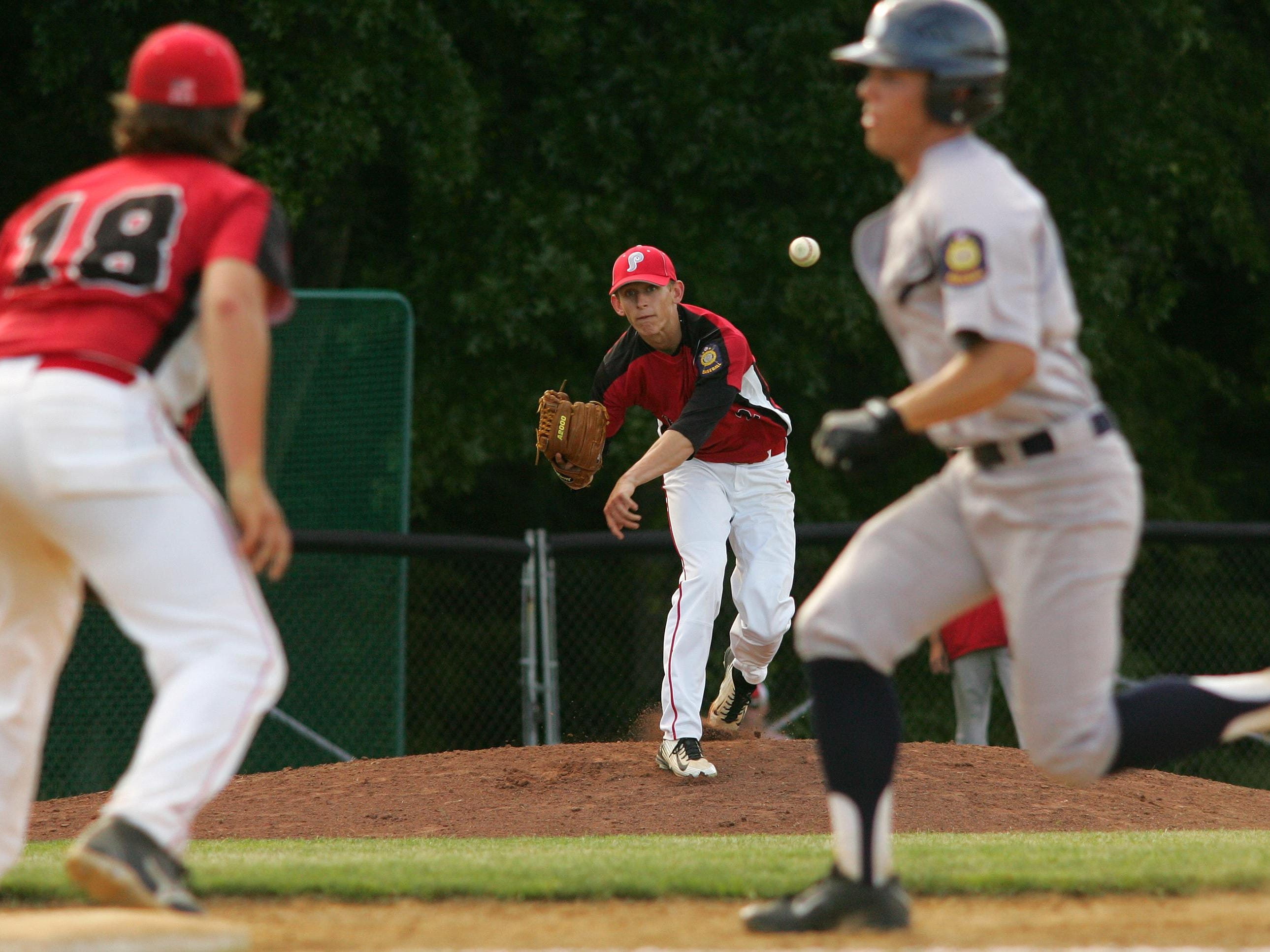 Pickerington Post 283 pitcher Cole Music makes a pickoff throw to teammate Doug Connor June 24 during the team's 12-2 victory against Lancaster Post 11. Music and Connor are two of four Watkins Memorial players on the team.