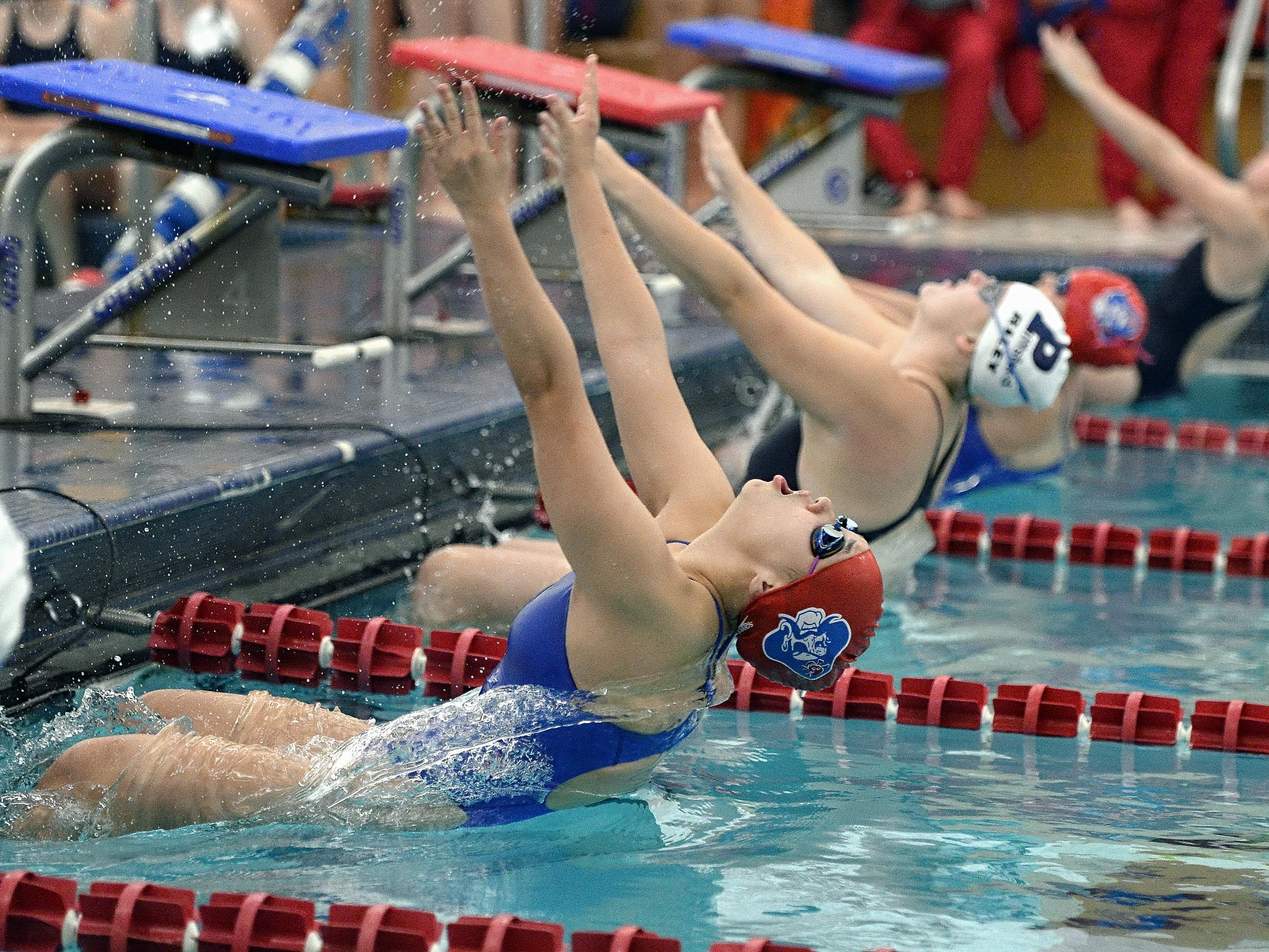 Fairport's Grace Chen, left, takes off from the blocks on her way to a win in the 100 yard backstroke during a meet against Pittsford held at Fairport High School on Tuesday, October 10, 2015.