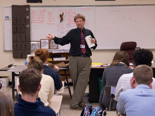 Larry Mattingly, a social studies teacher of 32 years, discusses World War II with his Memorial High School history class Monday afternoon.