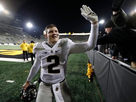 Purdue quarterback Elijah Sindelar celebrates with fans after upsetting Iowa on the road last season.