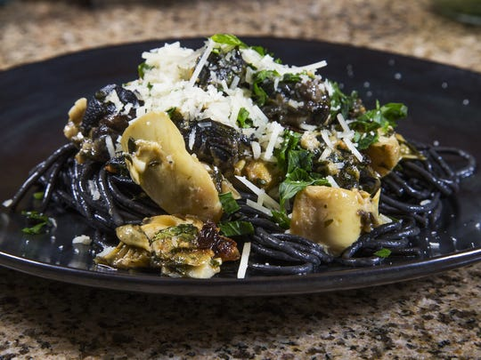 Top Home Chef finalist Laura Licona's squid ink pasta with chipotle escargot and artichoke hearts.