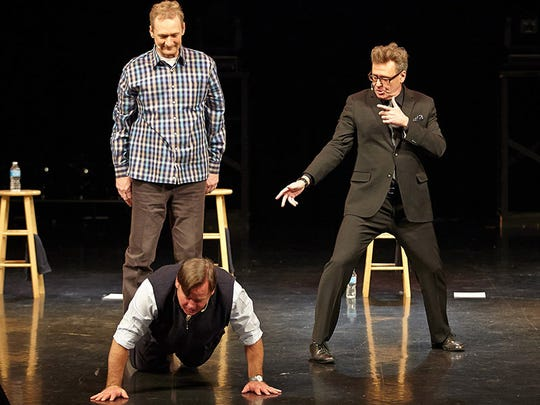 Ryan Stiles and Greg Proops order Joel Murray to do push-ups during a 'Whose Live' performance
