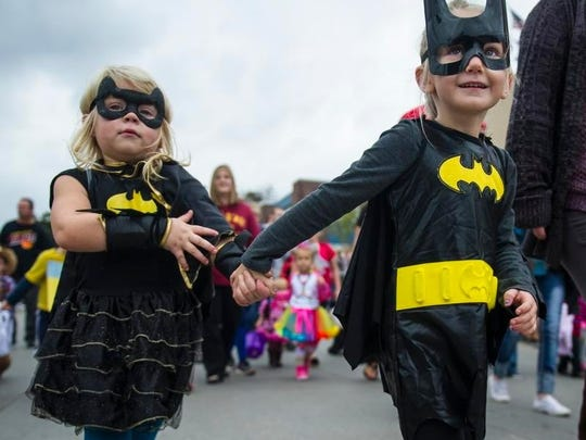 Brynlee Stewart, 3, and Callie White, 5, came to the Carlisle costume parade as batgirls.