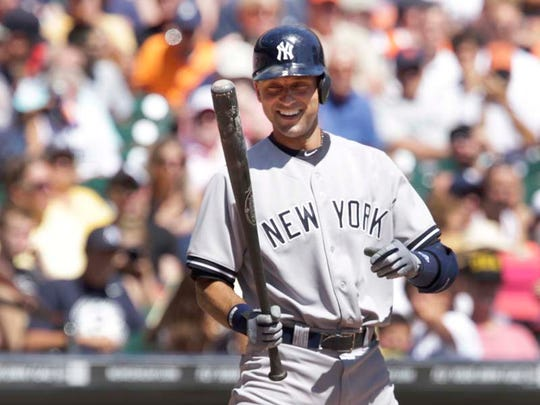 New York Yankees' Derek Jeter smiles in the batters box during third inning at Comerica Park on Aug. 27, 2014.