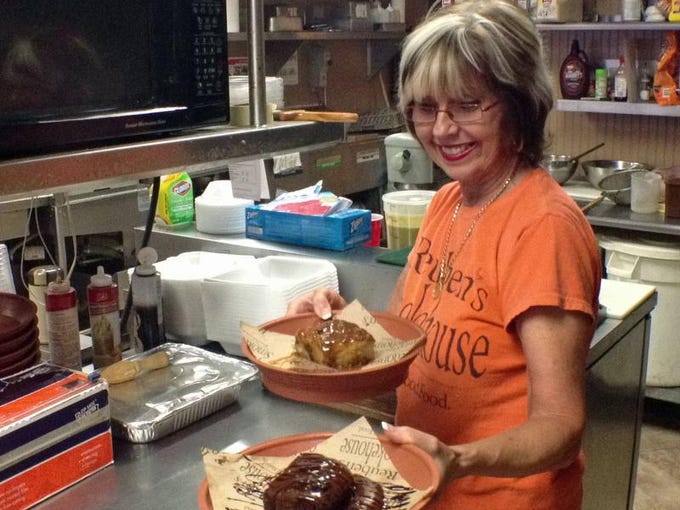 Arvey Krise prepares Gooey Fudgy Chocolaty Cake and Chocolate-Caramel Bread Pudding at Reuben's Smokehouse and Catering is on U.S. 41 in Fort Myers.