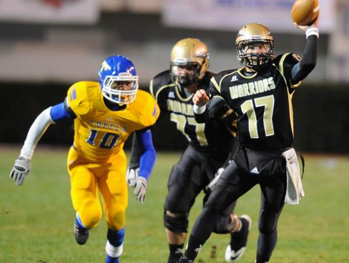 Oak Grove quarterback Kirk McCarty passes as they take on Tupelo.