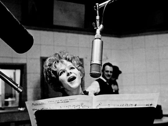 "Nashville singing star Brenda Lee cuts a record, singing in near-perfect German accents, on Feb. 29, 1964. Six years before, a 13-year-old Lee recorded ""Rockin' Around the Christmas Tree."""